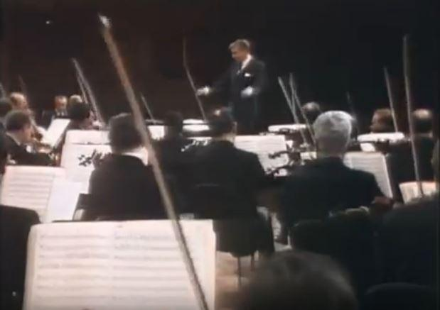 color photo of Leonard Bernstein conducting