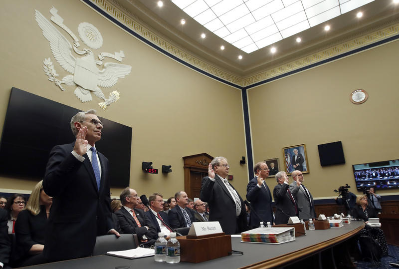 Cardinal Health board executive George Barrett, left, is sworn in before he testifies before a House committee.
