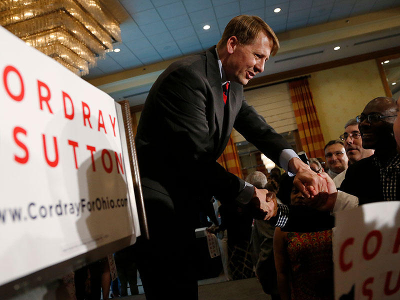Democratic gubernatorial candidate Richard Cordray shakes hands with supporters during an election night event Tuesday, May 8, 2018, in Columbus.