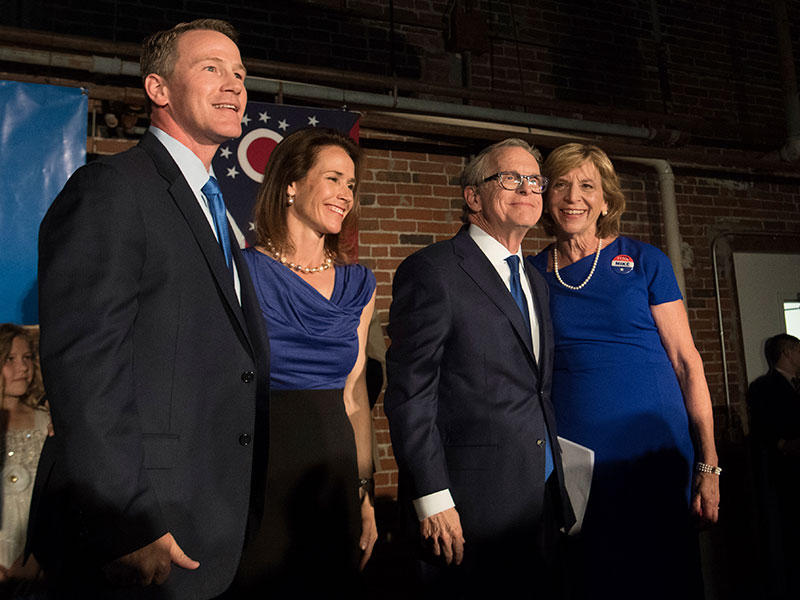 John Hosted, Republican candidate for Lieutenant Governor, from left, his wife Tina, stand with Republican gubernatorial candidate Mike DeWine and his wife Fran at an a primary election night rally, Tuesday, May 8, 2018, in Columbus