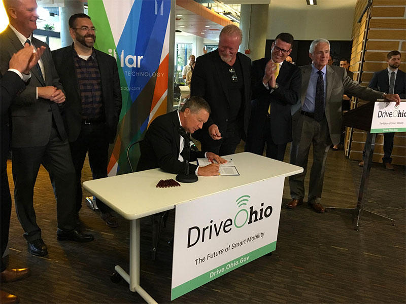 Gov. John Kasich signs an executive order on autonomous vehicle testing at Pillar Technologies in Columbus.