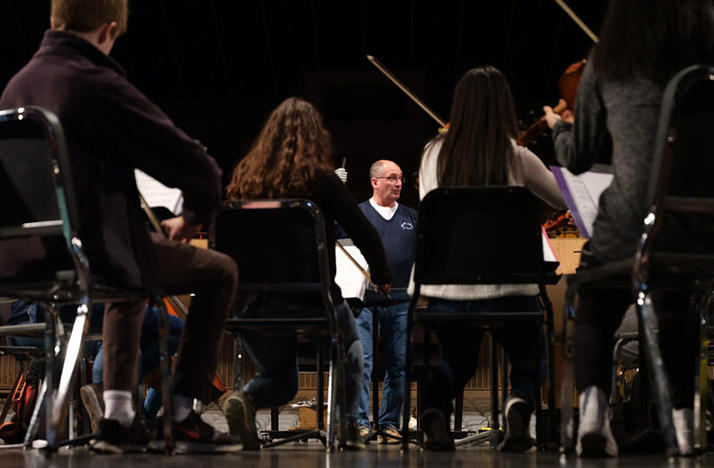 Upper Arlington Schools music teacher Ed Zunic leads the high school orchestra in a rehearsal of a new work by composer Richard Jordan Smoot.