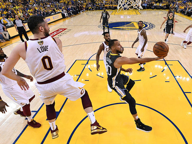 Golden State Warriors guard Stephen Curry, right, shoots against Cleveland Cavaliers forward Kevin Love (0) during the first half of Game 2 of basketball's NBA Finals in Oakland, Calif., Sunday, June 3, 2018.