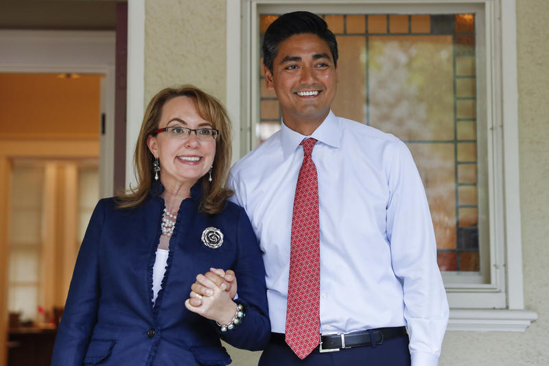 Former U.S. Rep. Gabby Giffords and Ohio congressional candidate Aftab Pureval at an event on June 13, 2018.