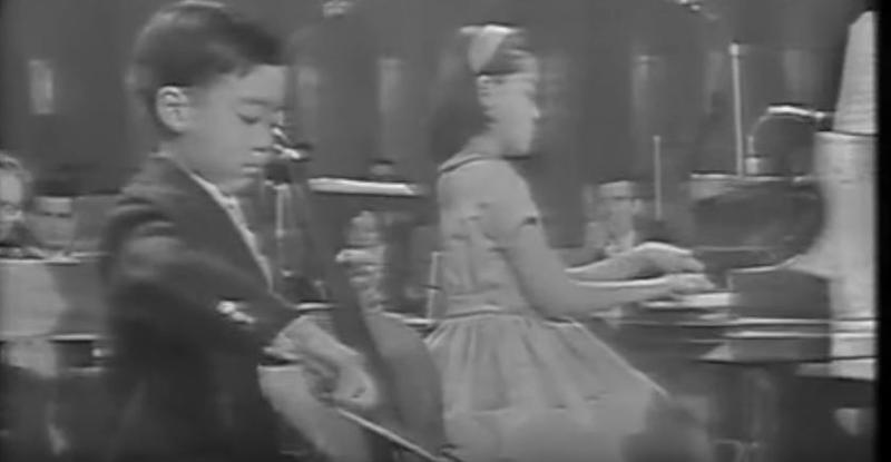 b&w image of the 7-year-old Yo-Yo Ma playing the cello while his sister, Yeou-cheng Ma, accomapnies at the piano
