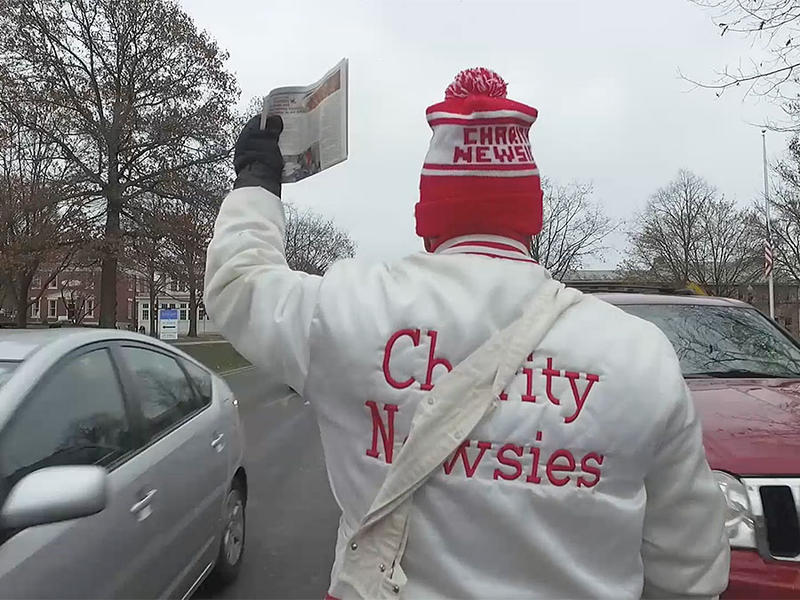 Charity Newsies selling newspapers in a Columbus intersection