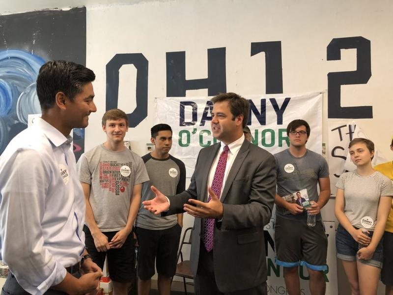 Ohio 12th District congressional candidate Danny O'Connor (center) talks to 1st District candidate Aftab Pureval (left).