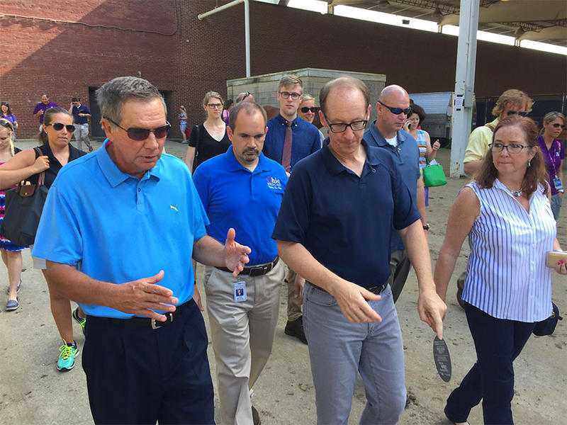 Ohio Department of Medicaid Director Barbara Sears (right) walking with Office of Health Transformation Director Greg Moody (middle) and Gov. John Kasich (left).