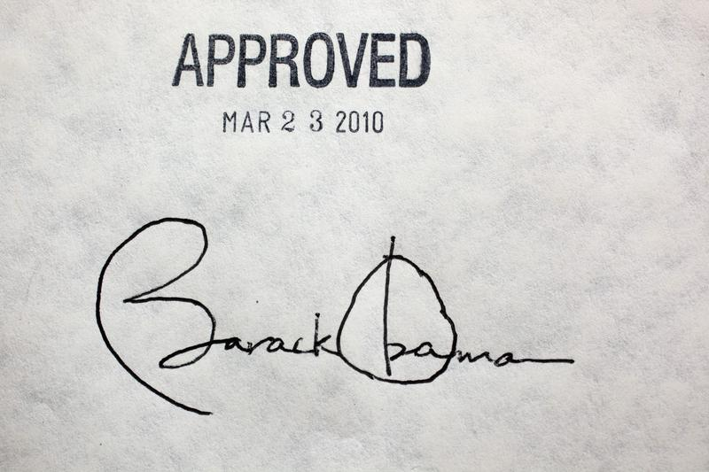 Former President arack obama's signature on the health insurance reform bill from Mach 23, 2010.