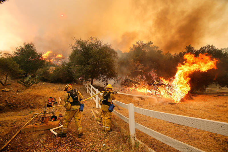Firefighters try to put out a fire in Hidden Valley, California in 2013. This summer's Mendocino Complex fire is the largest in California history.