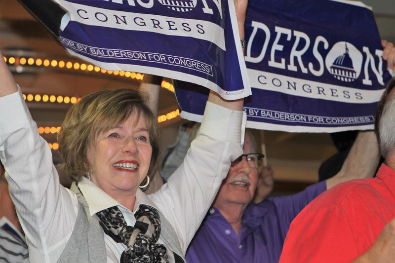 Troy Balderson supporters cheer at the Republican candidate's election night party on Tuesday, Aug. 7.
