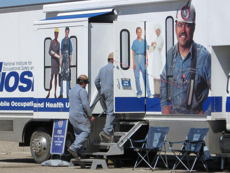 Miners walk into the mobile health clinic as it makes a stop in Morgantown, West Virgina.