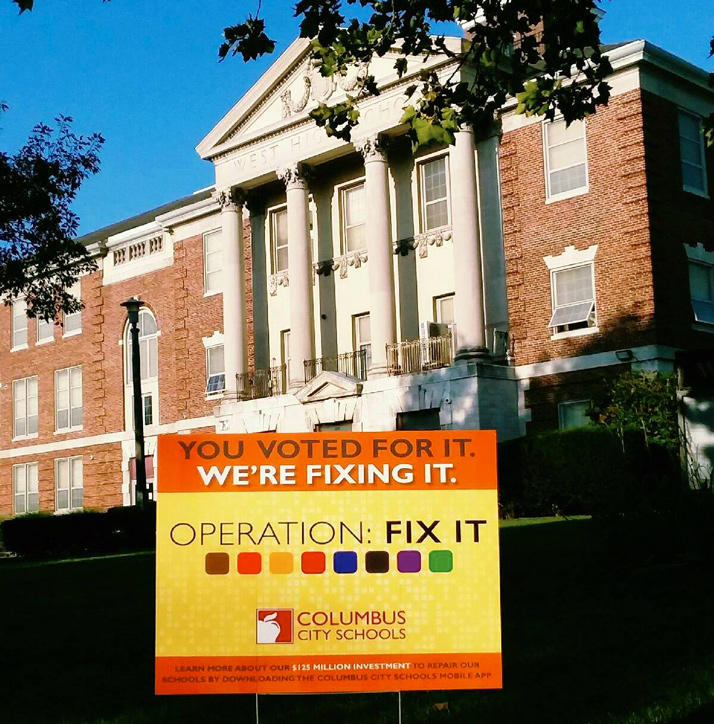 West High in Columbus with Operation Fix It sign