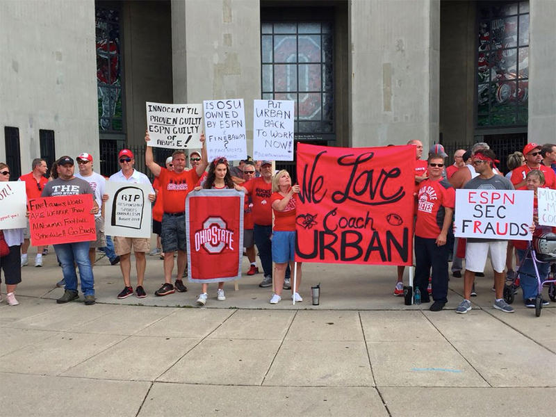 Fans rallied outside Ohio Stadium Monday night in support of Urban Meyer.