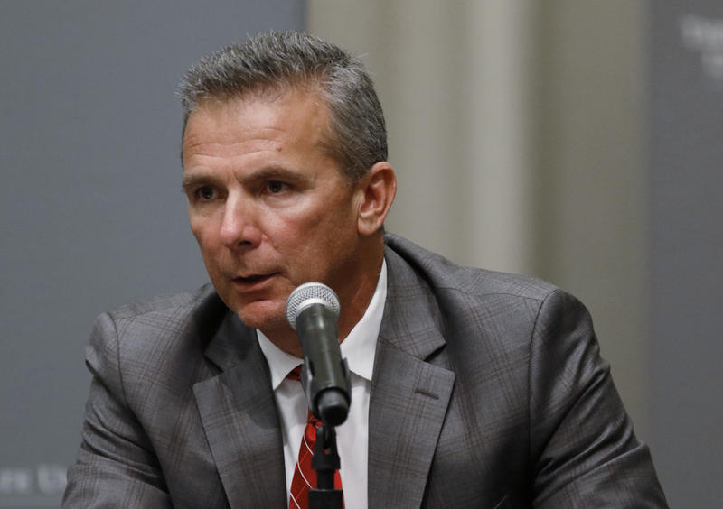 Ohio State football coach Urban Meyer makes a statement during a news conference.