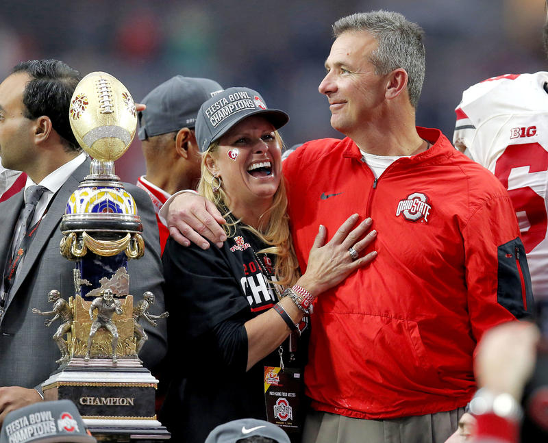 In this Jan. 1, 2016, file photo, Ohio State head coach Urban Meyer hugs his wife, Shelley, after their 44-28 win over Notre Dame.