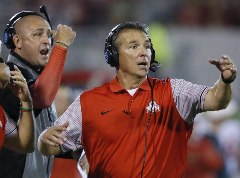 Ohio State head football coach Urban Meyer, right, and then-assistant coach Zach Smith, left, at a game in Oklahoma on Sept. 17, 2016.