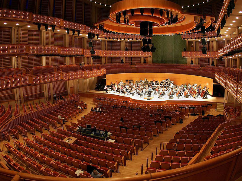 The New World Symphony rehearses on stage at The Knight Concert Hall in the Carnival Center for the Performing Arts October 3, 2006 in Miami, Florida. -