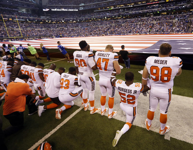 Members of the Cleveland Browns take a knee during the national anthem before an NFL football game against the Indianapolis Colts in Indianapolis, Sunday, Sept. 24, 2017.