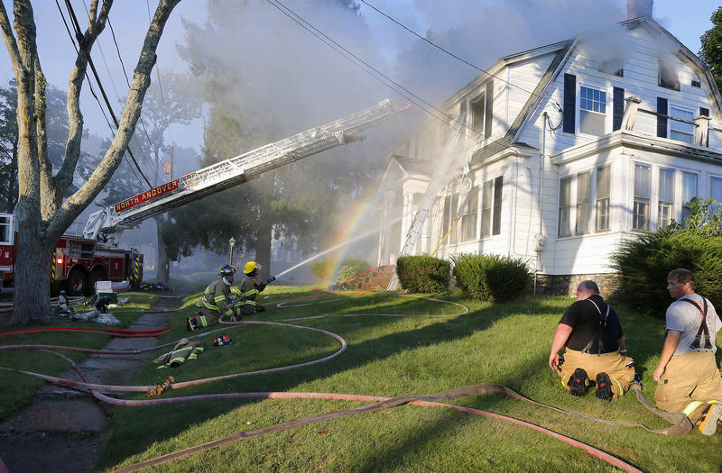 Firefighters battle a house fire, Thursday, Sept. 13, 2018, on Herrick Road in North Andover, Mass., one of multiple emergency crews responding to a series of gas explosions and fires triggered by a problem with a gas line.