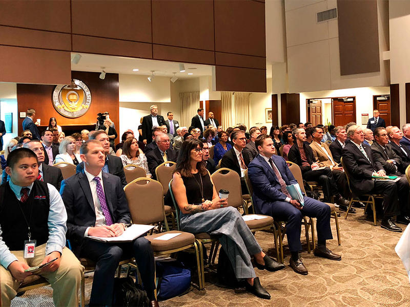 Prize winners and other observers look on Wednesday, Sept. 12, 2018, in Columbus, Ohio, as another $2.4 million is awarded through the Ohio Opioid Technology Challenge.
