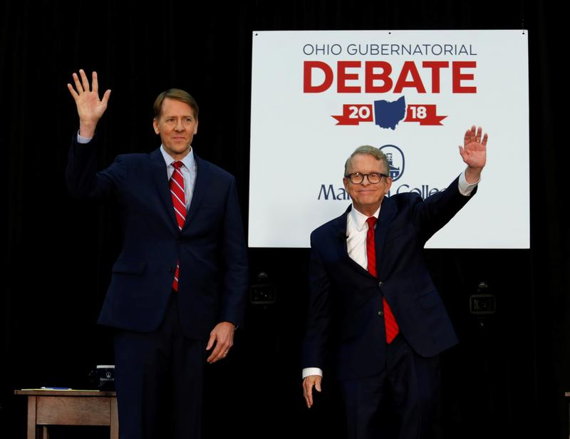 Democratic gubernatorial candidate Richard Cordray, left, and Ohio Attorney General and Republican gubernatorial candidate Mike DeWine wave to the crowd before a debate at Marietta College on Monday.