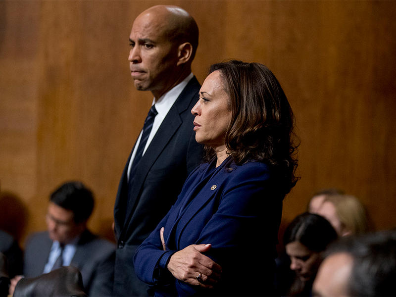Sen. Cory Booker, D-N.J., and Sen. Kamala Harris, D-Calif., listen as Sen. Jeff Flake, R-Ariz., speaks during a Senate Judiciary Committee hearing on Supreme Court nominee Judge Brett Kavanaugh, Friday, Sept. 28, 2018, on Capitol Hill in Washington.