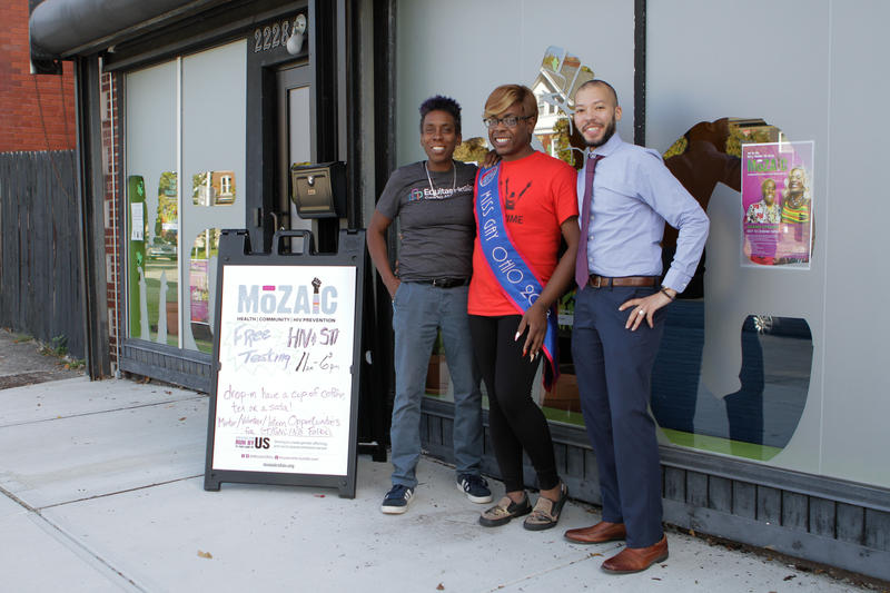 Luster Singleton, Mikayla Robinson, and Cory Frederick stand in front of Mozaic in Columbus.