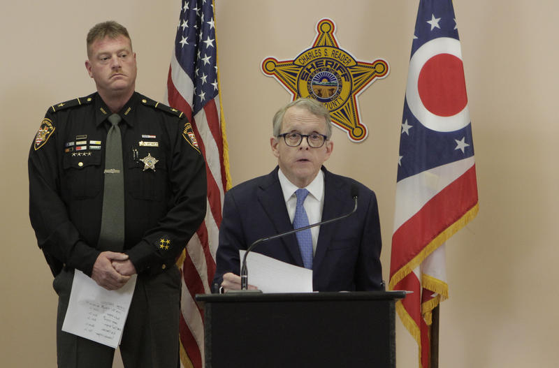 Attorney General Mike DeWine flanked by Pike County Sheriff Charles Reader.