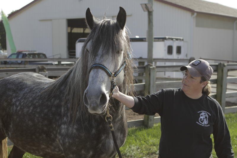 Officer Sandra Silva with Jack, a retiring Columbus Police horse.