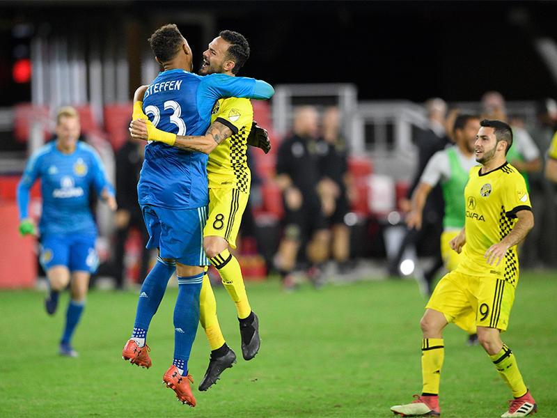 Columbus Crew SC goalkeeper Zack Steffen (23) celebrates with midfielder Artur (8) and defender Milton Valenzuela, right, after winning an MLS playoff soccer match in penalty kicks against D.C. United, Thursday, Nov. 1, 2018, in Washington.