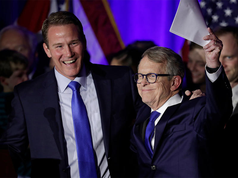 Lieutenant governor-elect Jon Husted and governor-elect Mike DeWine celebrate at the Ohio Republican Party event, Tuesday, Nov. 6, 2018, in Columbus, Ohio.