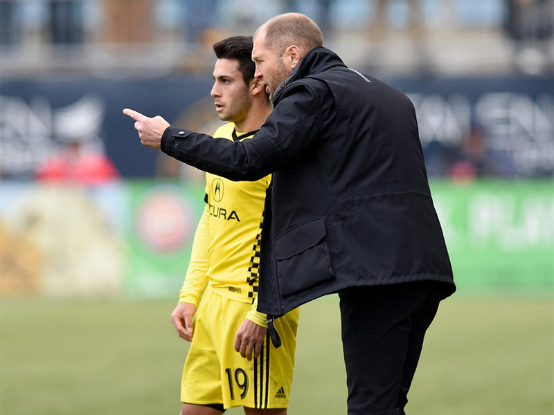 Columbus Crew coach Gregg Berhalter talks with Milton Valenzuela (19) during a break in play of an MLS soccer match against the Philadelphia Union on March 17, 2017, in Chester, Pa.