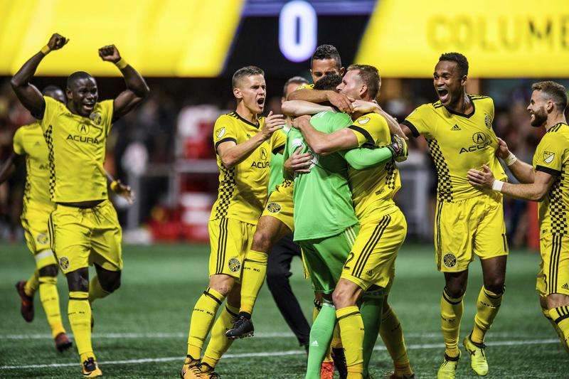 Columbus Crew players celebrate the game-winning goal after an MLS playoff soccer game against Atlanta United, in Atlanta, Thursday, Oct. 26, 2017.