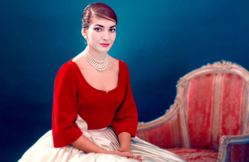 color photo of soprano Maria Callas, sitting and posing