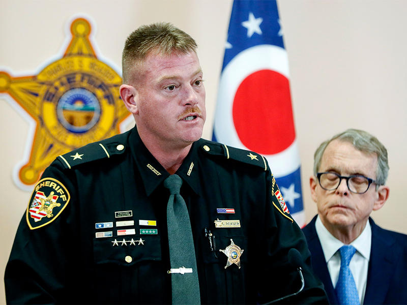 Pike County Sheriff Charles Reader, left, speaks alongside Ohio Attorney General Mike DeWine, right, during a news conference to discuss developments into the slayings of eight members of one family in rural Ohio two years ago, Tuesday, Nov. 13, 2018.