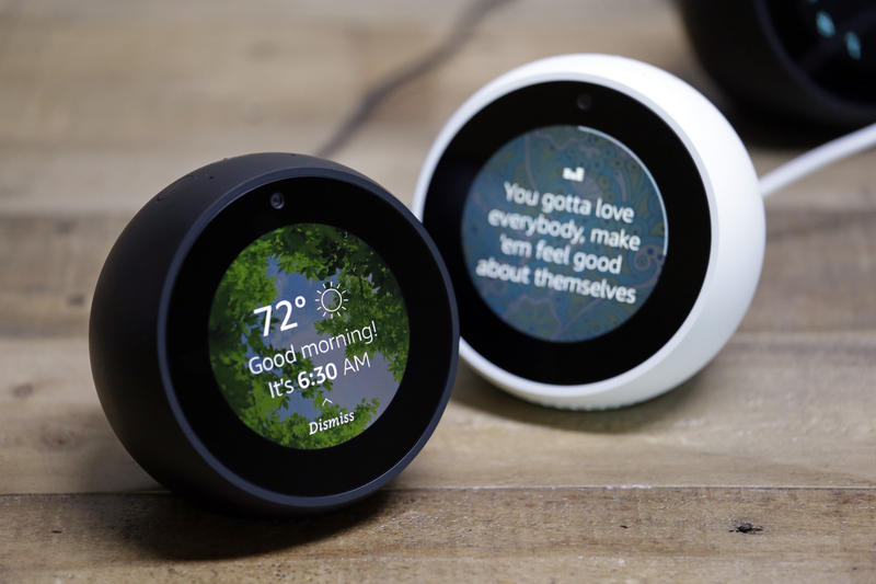 In this Wednesday, Sept. 27, 2017, file photo, Amazon Echo Spots are displayed during a program announcing several new Amazon products by the company, in Seattle.