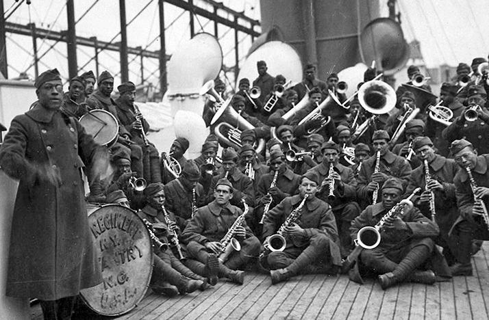 Lt. James Reese Europe poses with the jazz band of the 369th Infantry Regiment on the way home from war.