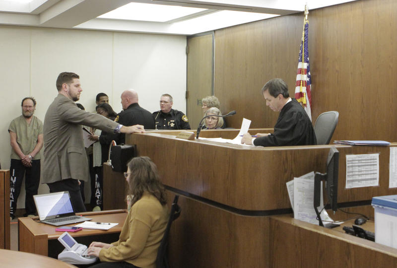 Judge Hummer presiding over arraignment hearings in Courtroom 4D.