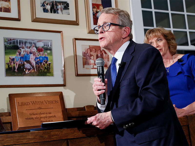 Ohio Gov. Mike DeWine speaks before signing his first executive action alongside his wife Fran, Monday, Jan. 14, 2019, in Cedarville, Ohio. The former U.S. senator took his oath in a private midnight ceremony at his Cedarville home ahead of a public inaug