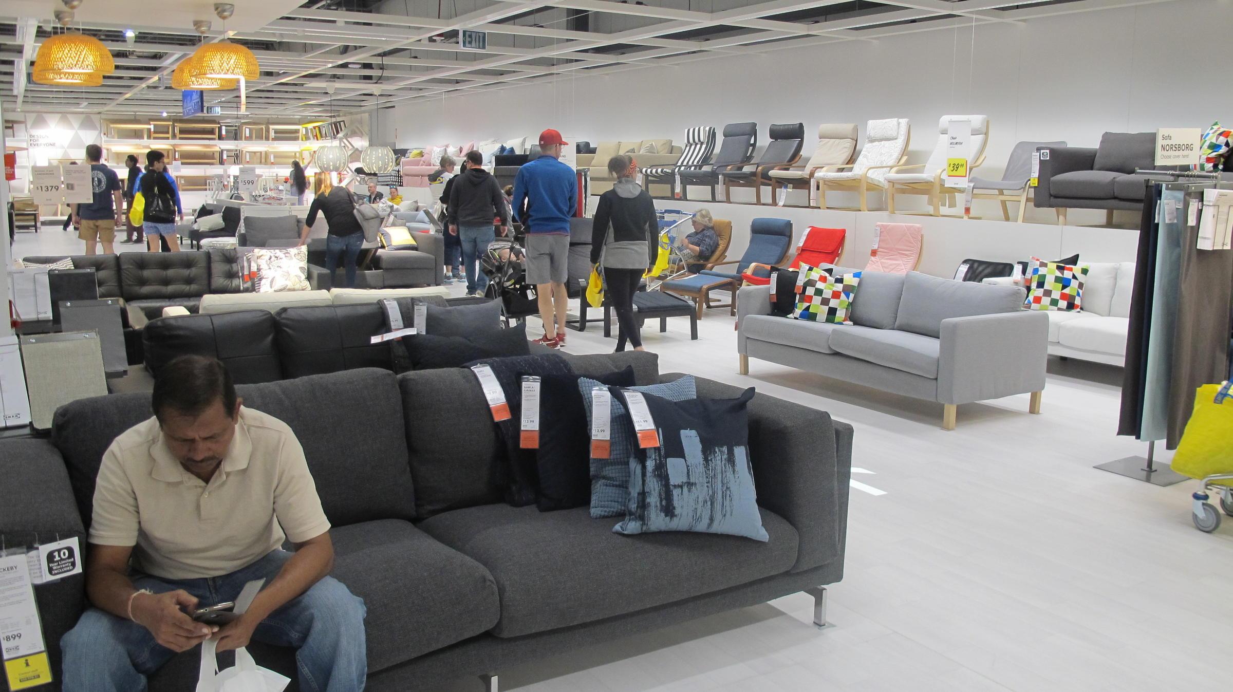 Shoppers Walking Around An IKEA Chair Showroom
