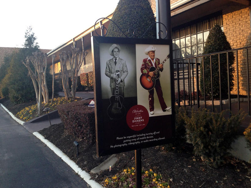 Side-by-side portraits of Little Jimmy Dickens mark his more than 60 years with the Grand Ole Opry. Dickens died Jan. 2 at age 94.
