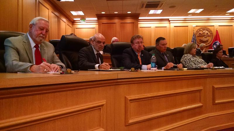 Rep. Sabi Kumar, second from left, takes notes during a committee meeting earlier this month.