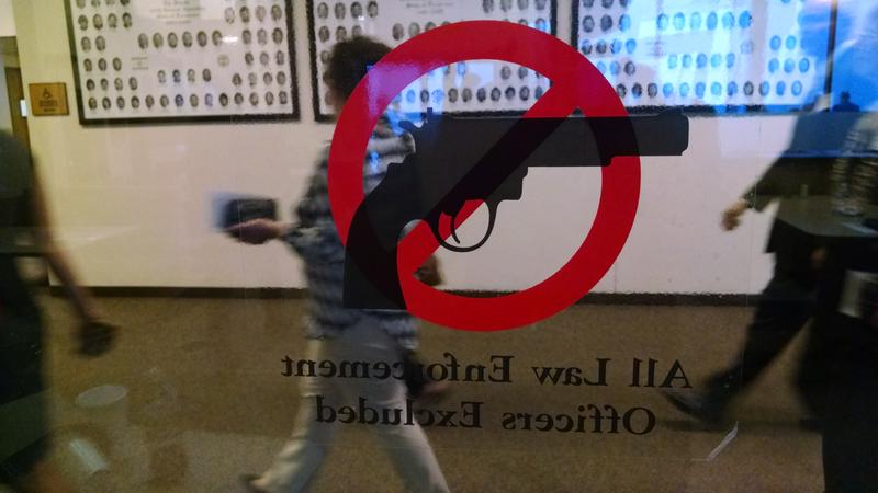 A sign in Legislative Plaza indicates guns are banned in the State Capitol complex.