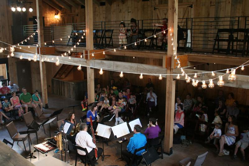 Intersection's first family concert was performed in a barn-like space that allowed children to sit all around the musicians, close enough for curious kids to get a good look.