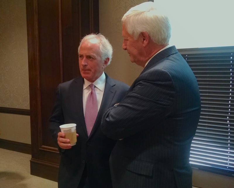 Sen. Bob Corker chatted with Belmont University President Bob Fisher before a question-and-answer session last month. Corker says the Obama administration missed its chance to head off the Syrian refugee crisis.