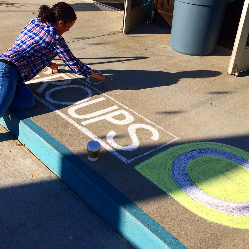 Here's Lindsay Gallagher creating chalk art on a Nashville sidewalk.