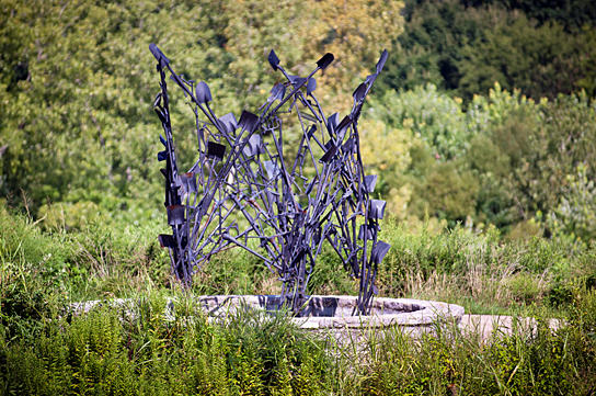 """Tool Fire,"" by artist Christopher Fennell, stands at the intersection of the Shelby Bottoms Greenway and a pedestrian bridge to Two Rivers Park"