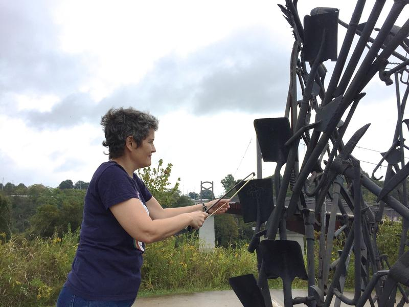 "Sound artist Robbie Lynn Hunsinger opted to play the sculpture ""Tool Fire"" as an instrument in her composition."