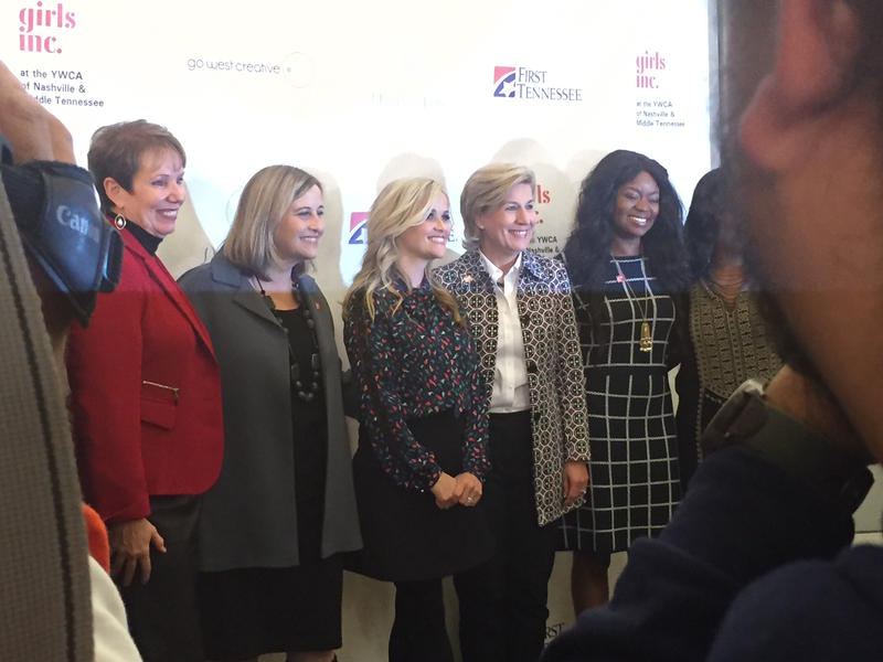 """Reese Witherspoon, center, takes photos with Mayor Megan Barry and others before the YWCA's """"Girls Just Wanna Have Funds"""" event."""